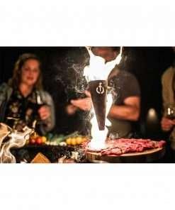 Sfeerbeeld | Churrasco Forged Flambadou | brandend vet boven vlees